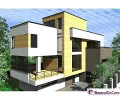 Bucium, casa la rosu cu o arhitectura moderna